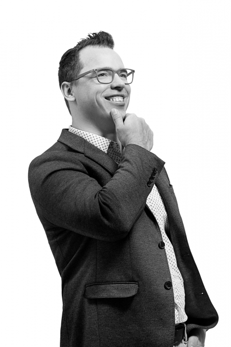 portrait of a business man on white smiling - portrait photography