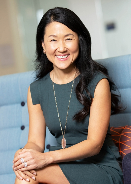 portrait of a professional woman smiling on couch - portrait photography