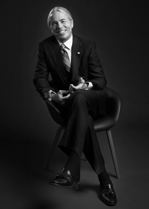 portrait of a business man sitting in a chair - portrait photography