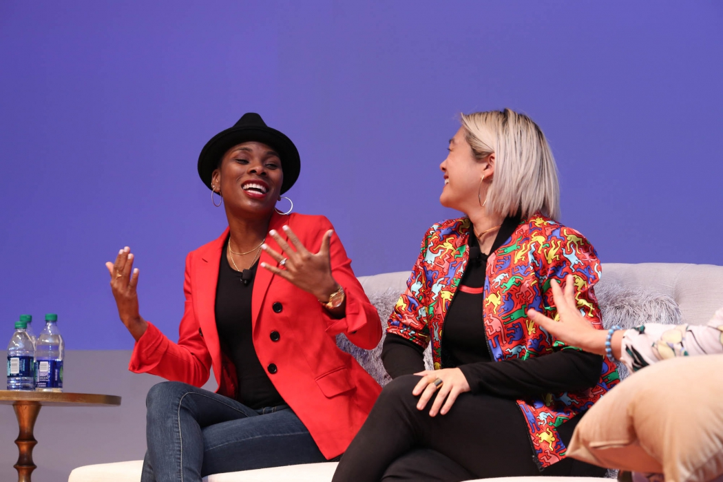 A few people on a stage speaking - P&G event photography