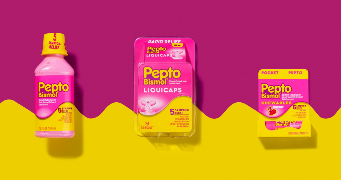 Pepto bismol liquid caps flat lay on color - p&g product photography
