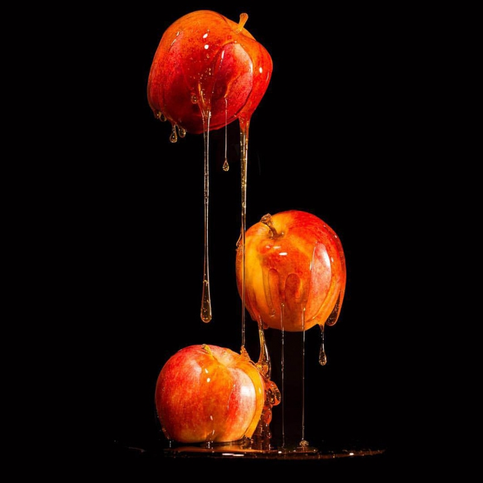 Apples dripping on black - p&g product photography