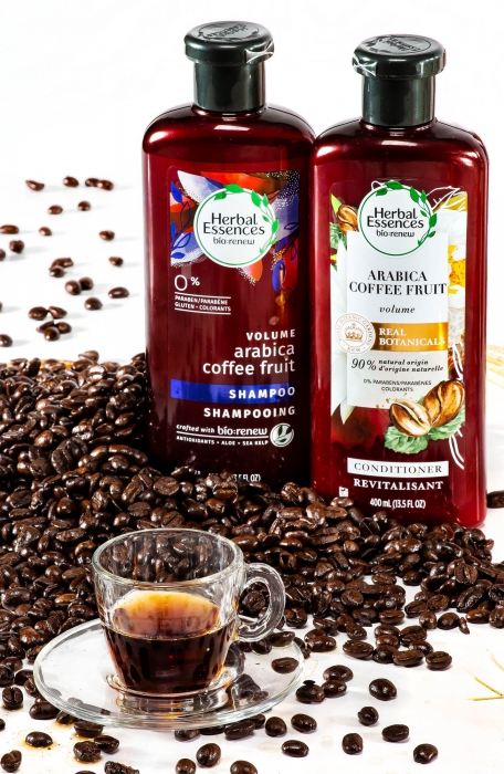 Two herbal essence bottles with coffee beans - P&G Product Photography