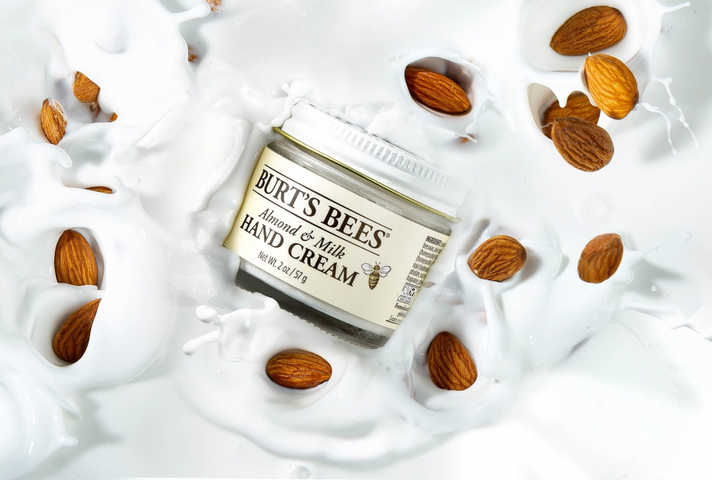 Burts Bees Photo of Product splashing in cream and almonds - P&G Product Photography