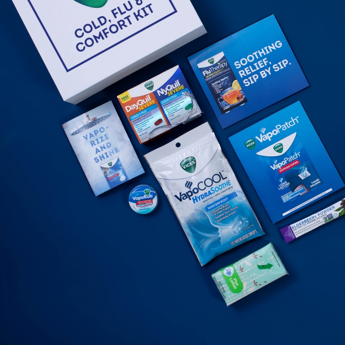 Vicks family flat lay on blue - p&g product photography