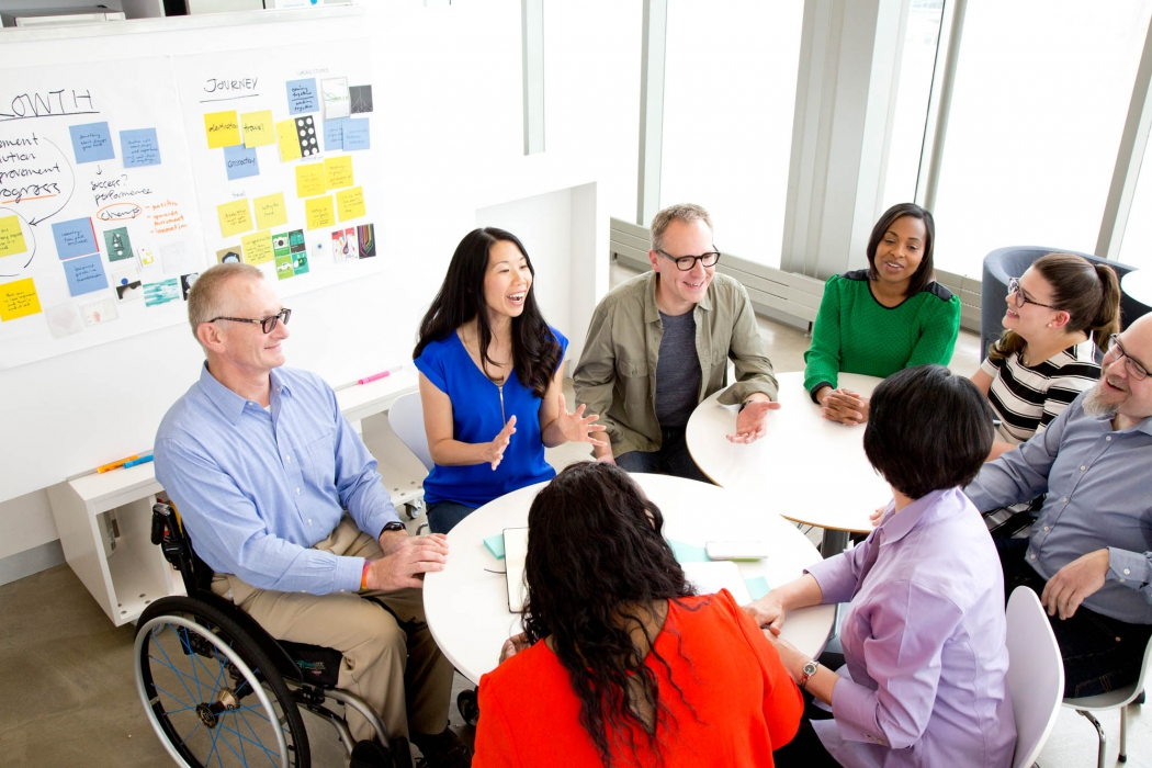 happy professionals sit together for a meeting at p&g - workplace photography
