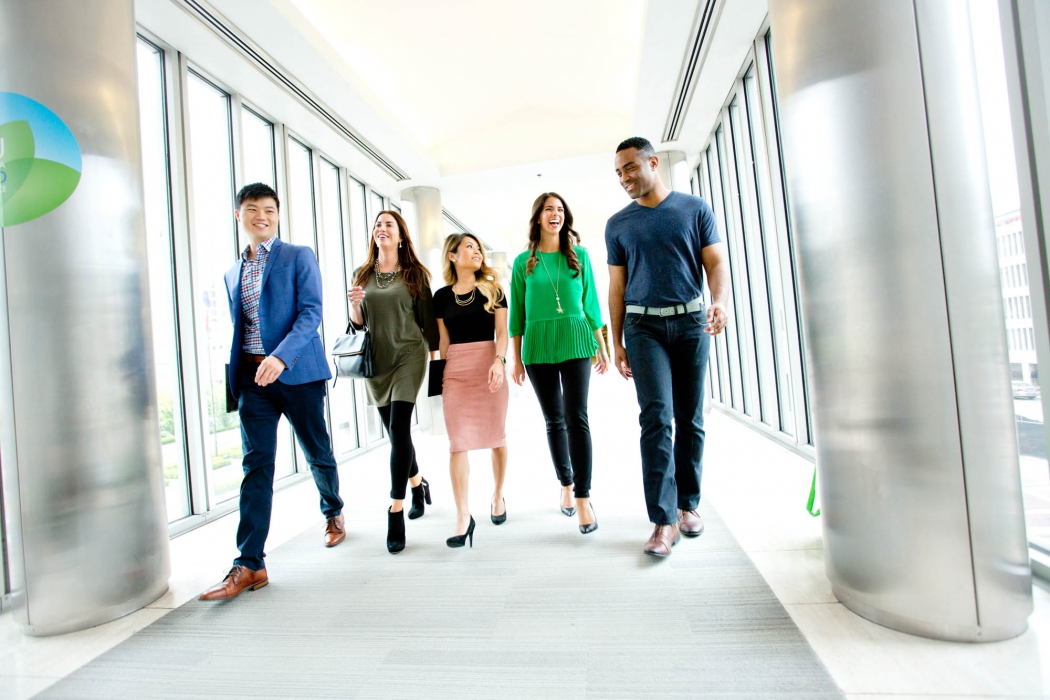 a group of professionals walks together at a p&g - workplace photography