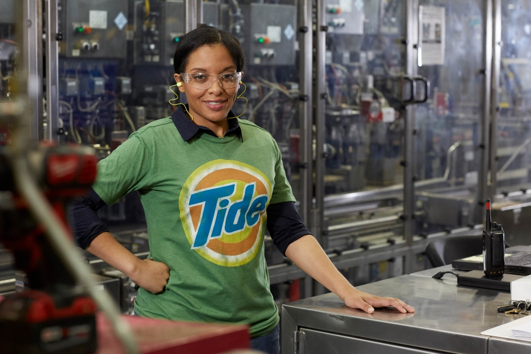 happy woman works at p&g plant - workplace photography