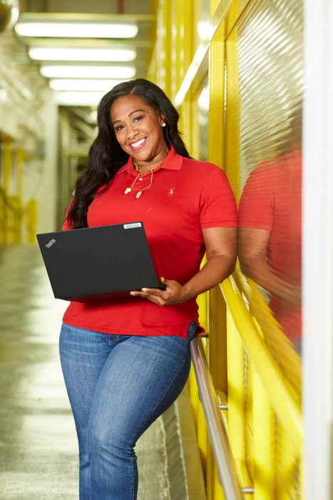 workplace photography of woman leaning with laptop p&g