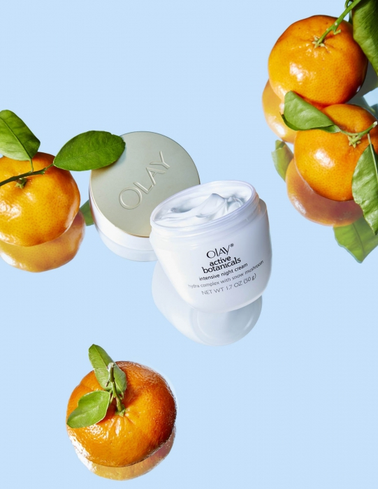 Olay botanical on blue with oranges - P&G Product Photography