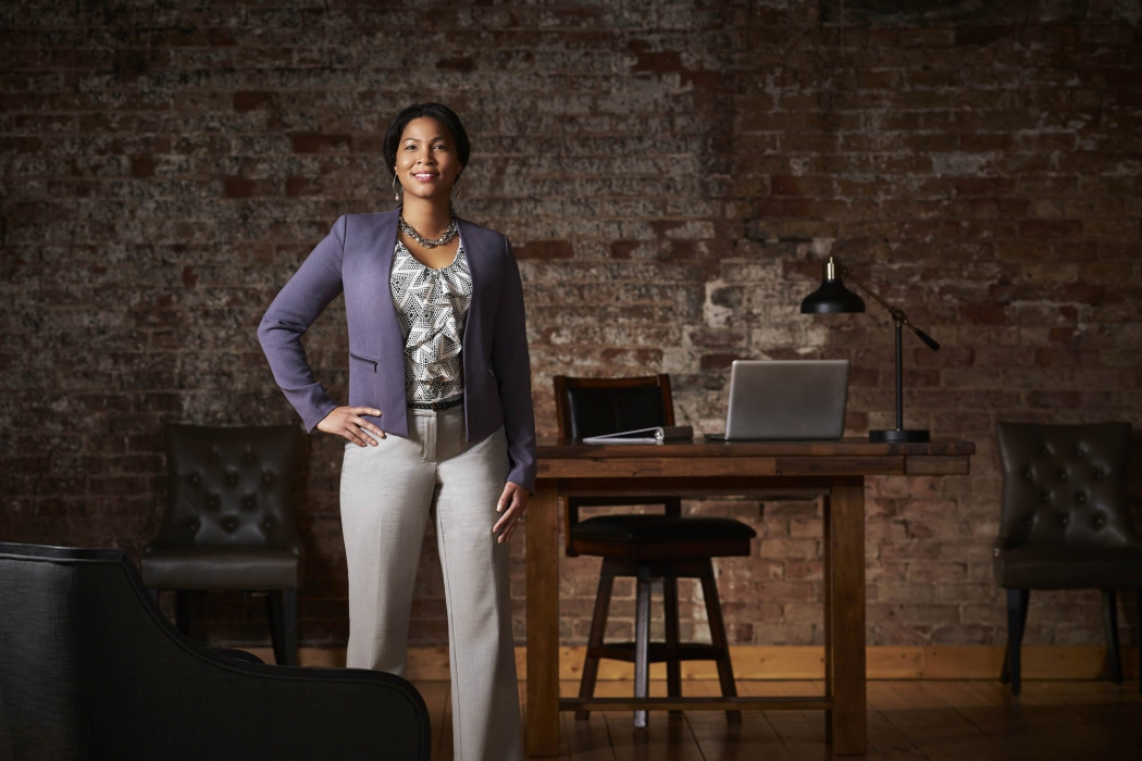 Portrait of a professional woman in a modern brick walled office - portrait photogrpahy