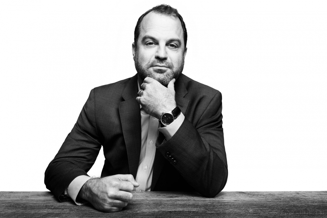 Portrait of a professional man at a table in black and white - portrait photography