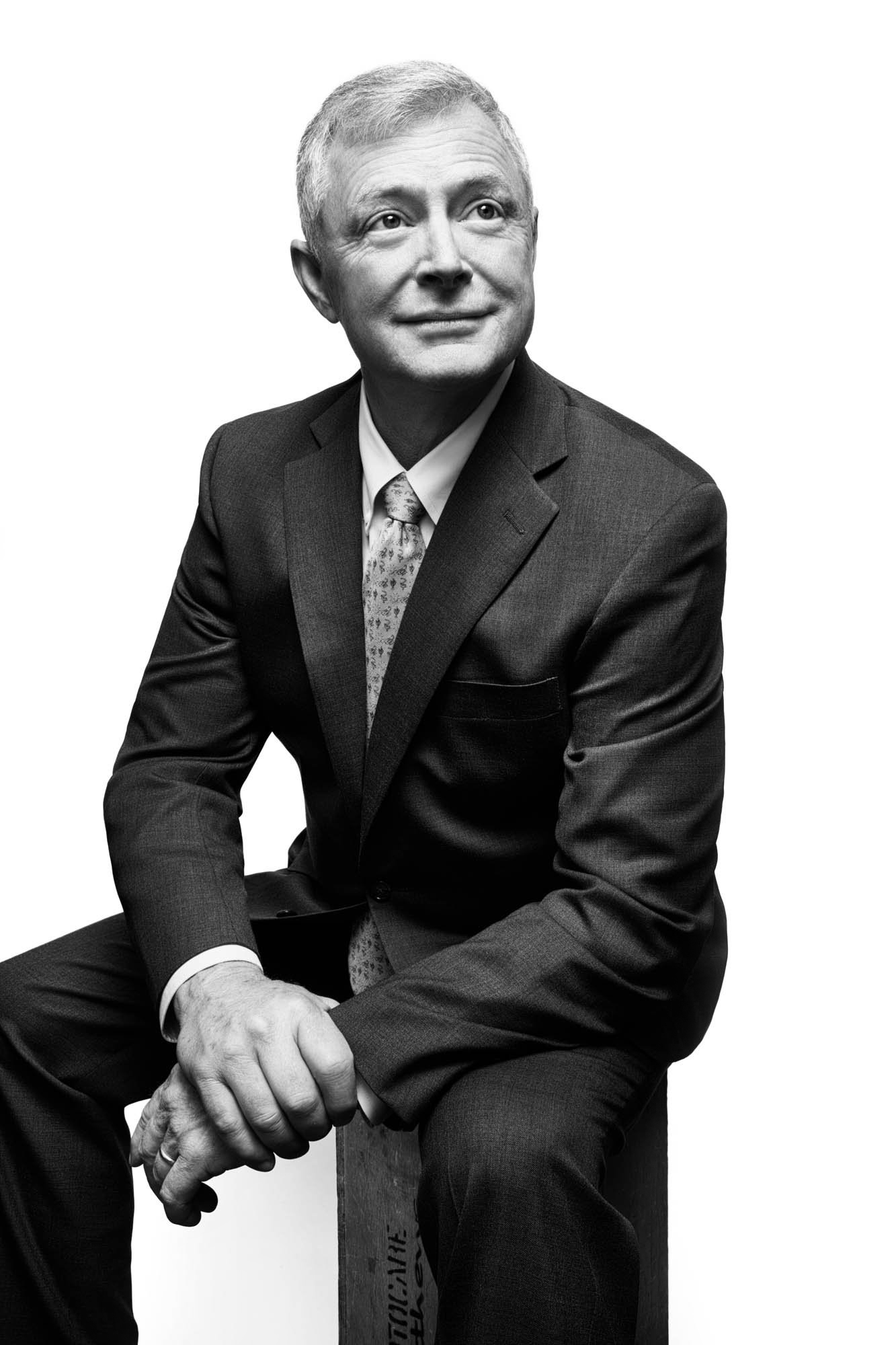 Portrait of a professional man sitting on a box with suit - portrait photography