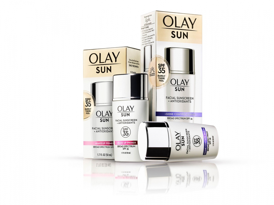 Olay product family on white with chrome tops - product photography
