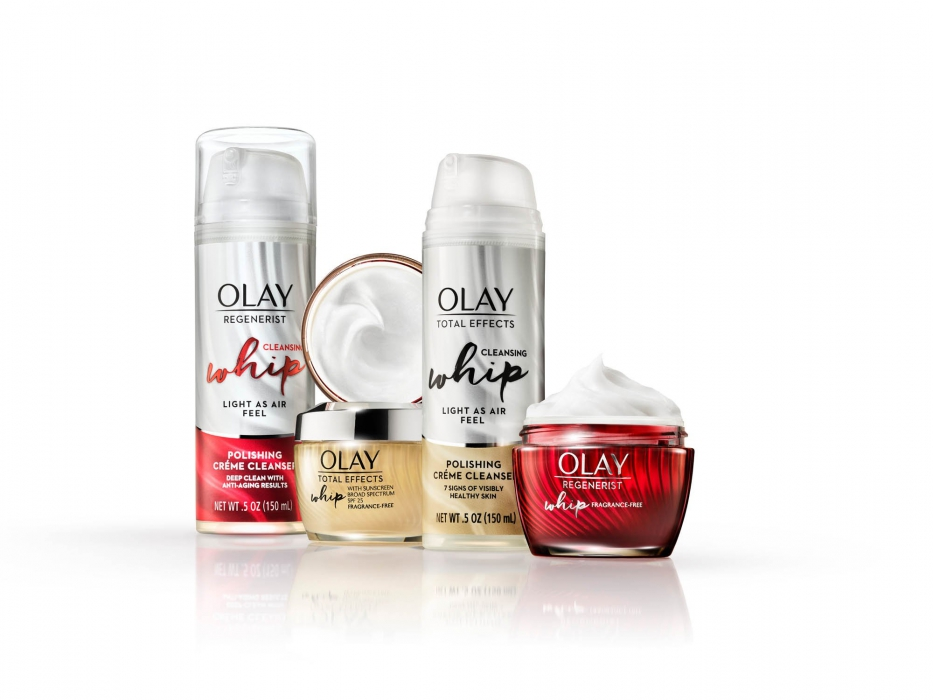Olay product family on white with whips and gold - P&G product photography