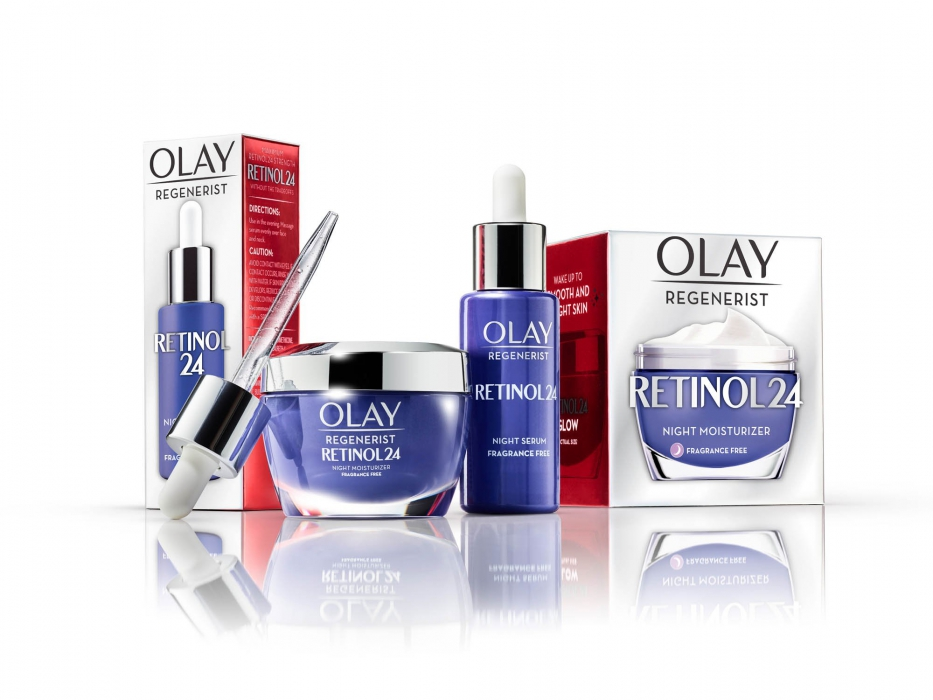 Olay family retinol cream and dropper on white with reflections - P&G product photography