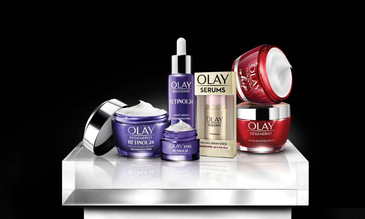 Olay products on a white pedestal on a black background - P&G product photography