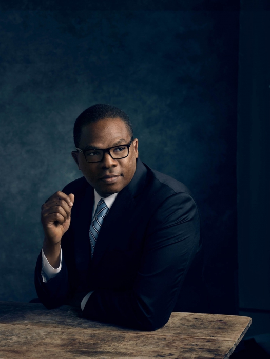 Portrait of a professional man in color on a dark background - portrait photography
