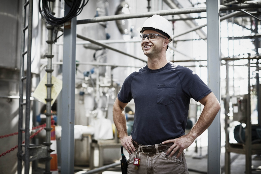 A Happy man working at industrial P&G plant - Workplace Photography