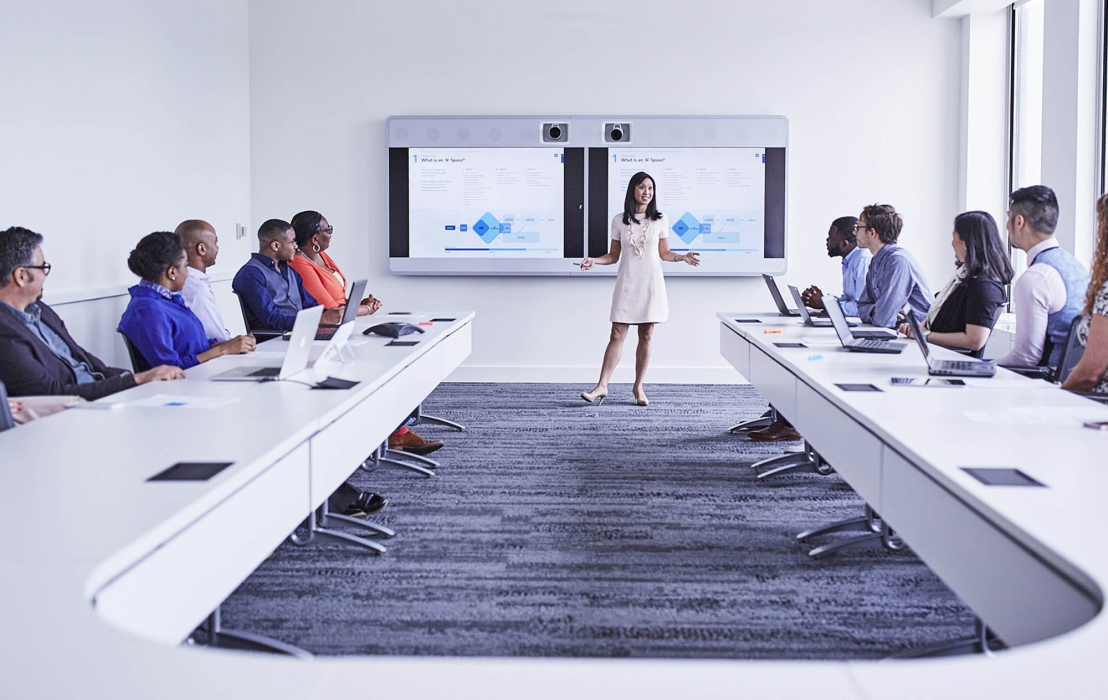 A person addressing a conference room inside P&G