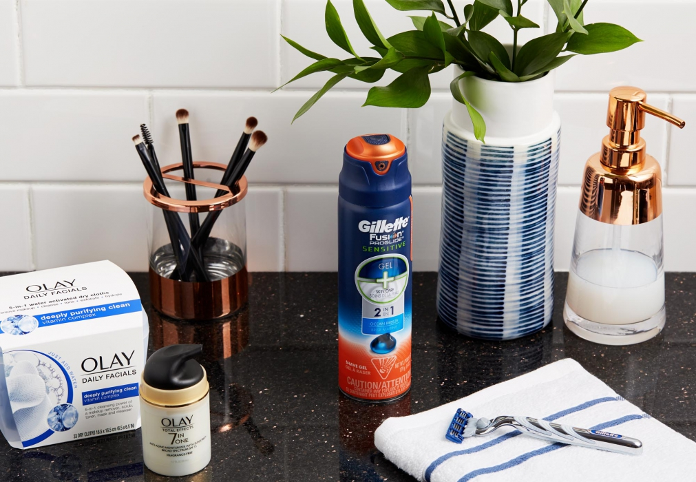 Gilettel shaving cream, razor and OLay facials and 7 in one on bathroom counter - product photography