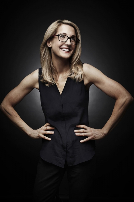 Portrait of a professional woman on a dark background - portrait photography